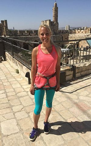 Heather Larsen, a world-renowned 'slacker', whose highline tricks brought her to Jerusalem's Tower of David Museum to help promote the 'Joey' bag, designed for better body balance (Jessica Steinberg/Times of Israel)
