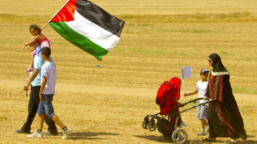 A family walking during the procession of the March of Return, which took place in the Negev desert on May 12, 2016. (Dov Lieber / Times of Israel)