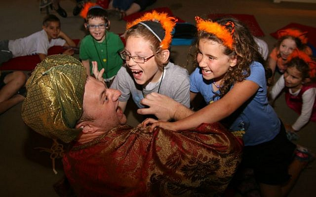 Children engage with storyteller at Tower of David Museum's Passover program for families with children with special needs, April 2016 (Ricky Rachman)