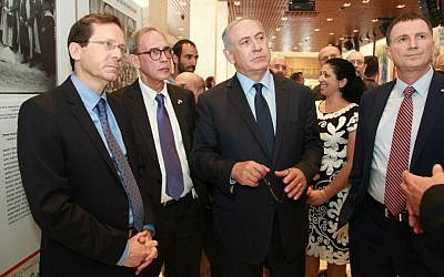 From left to right, opposition leader Isaac Herzog, MK Nachman Shai, Prime Minister Benjamin Netanyahu and Knesset Speaker Yuli Edelstein tour 'Strips, Stars and Magen David' exhibition at Knesset's celebration of the American Jewish contribution to the State of Israel, May 25, 2016. (Isaac Harari/Knesset Media and Public Relations)