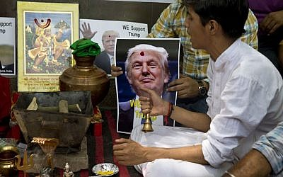 Activists of right-wing Hindu Sena or Hindu Army conduct Hindu rituals to ensure a win for U.S. presidential candidate Donald Trump, in New Delhi, India, Wednesday, May 11, 2016. (AP Photo/Saurabh Das)