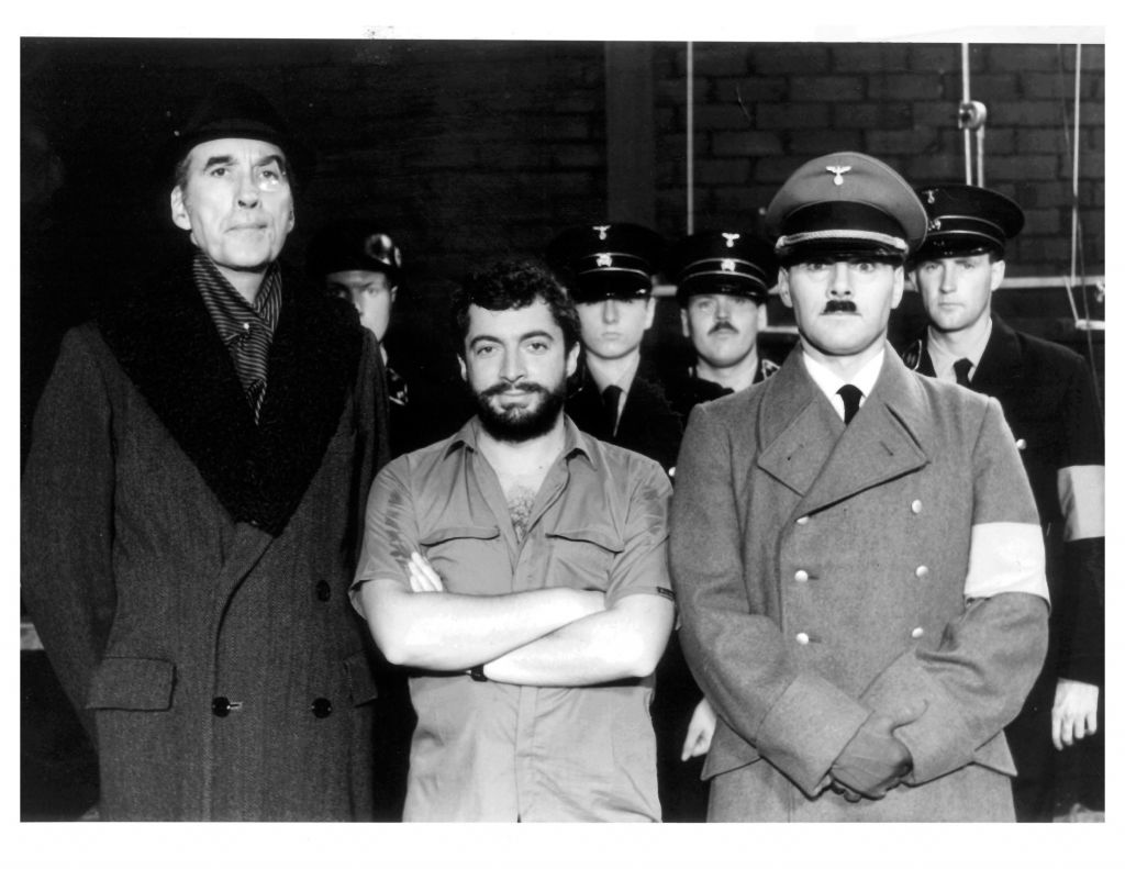 Mora, center, with the actors portraying Hitler and the SS on the set of his 1983 movie 'The Return of Captain Invincible' (courtesy)