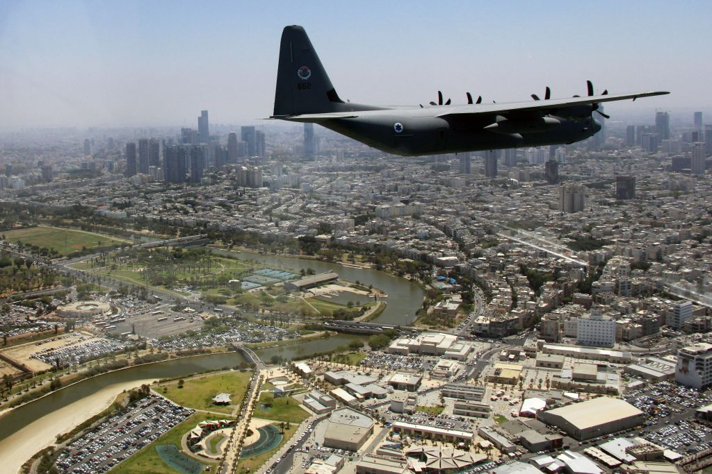 A C-130J Super Hercules cargo plane flies over Tel Aviv's Hayarkon River as part of the Israeli Air Force's annual flyby on Independence Day, May 12, 2016. (Judah Ari Gross/Times of Israel)