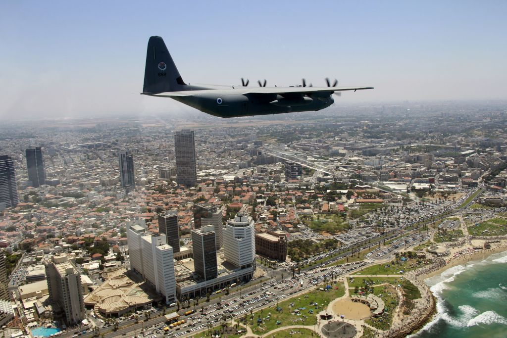 A C-130J Super Hercules flies over southern Tel Aviv as part of the Israeli Air Force's annual flyby on Independence Day, May 12, 2016. (Judah Ari Gross/Times of Israel)