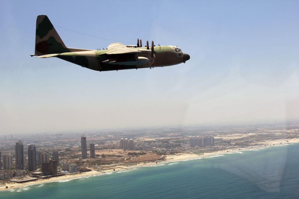 A C-130 Hercules cargo plane flies over coastal Israel as part of the Israeli Air Force's annual flyby on Independence Day, May 12, 2016. (Judah Ari Gross/Times of Israel)