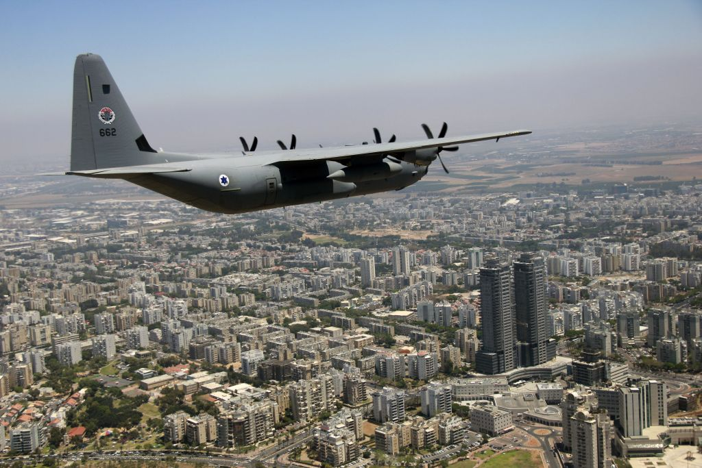 A C-130J Super Hercules flies over the city of Ashdod as part of the Israeli Air Force's annual flyby on Independence Day, May 12, 2016. (Judah Ari Gross/Times of Israel)