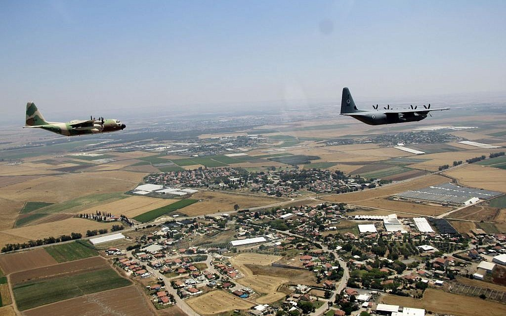 A C-130J Super Hercules and a C-130 Hercules fly over Israel as part of the Israeli Air Force's annual flyby on Independence Day, May 12, 2016. (Judah Ari Gross/Times of Israel)