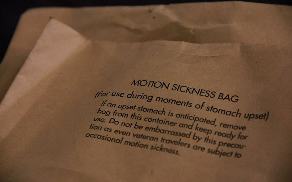 A motion sickness bag provided by the air force. 'Even veteran travelers are subject to occasional motion sickness,' the envelope for the bag reads. (Judah Ari Gross/Times of Israel)