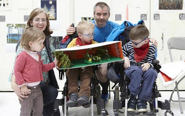 A family participating in a workshop for children with special education needs at the Royal Academy of Arts in London. (Richard Dawson)