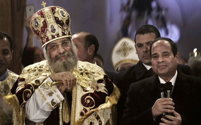 Egypt's President Abdel-Fattah el-Sissi, right, visits Coptic Pope Tawadros II, during Christmas Eve mass at St. Mark's Cathedral, in Cairo, Egypt, January 6, 2015. (AP Photo/Nariman El-Mofty, File)