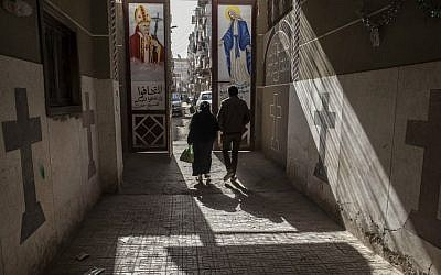 Coptic Christians walk outside St. Markos Church in Minya, south of Cairo, Egypt, January 2015. (AP Photo/Roger Anis)