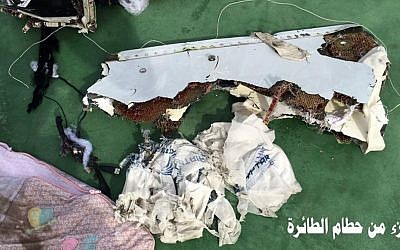 This picture posted Saturday, May 21, 2016, on the official Facebook page of the Egyptian military's spokesman shows part of the wreckage from EgyptAir flight 804. Arabic reads: 'Part of plane wreckage.' (Egyptian Armed Forces Facebook via AP)