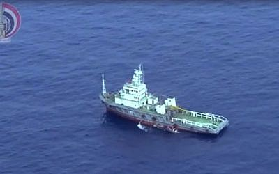 This still image taken from video posted Saturday, May 21, 2016, on the official Facebook page of the Egyptian Armed Forces spokesman shows an Egyptian ship collecting wreckage of EgyptAir flight 804. (Egyptian Armed Forces via AP)