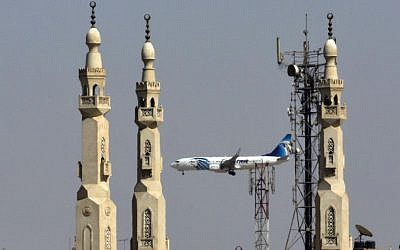 An EgyptAir plane flies past minarets of a mosque as it approaches Cairo International Airport, in Cairo, Egypt, Saturday, May 21, 2016. (AP Photo/Amr Nabil)