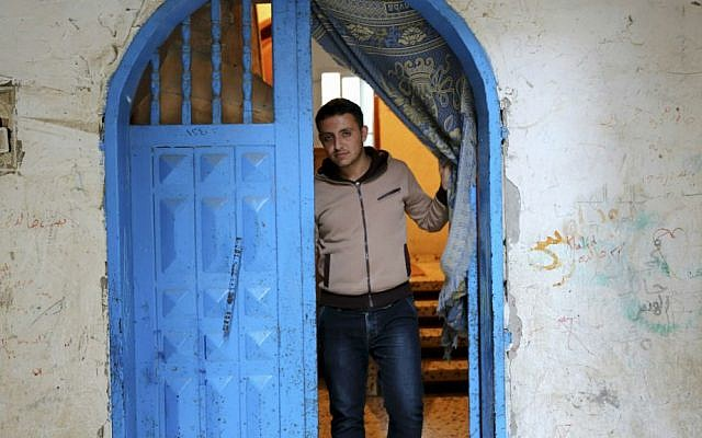 In this Tuesday, May 10, 2016 photo, Mohammed Al-Hissi, 25, who won a scholarship for a Master's program in physics at the University of Triesta in Italy, poses for a photo at his family home in Gaza City. (AP Photo/Adel Hana)