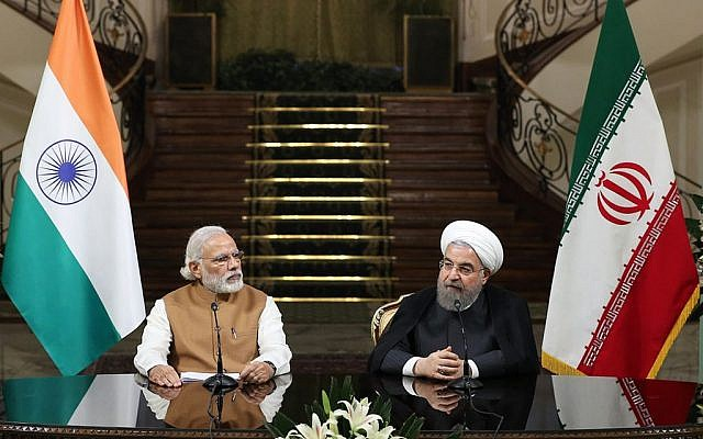 Iranian President Hassan Rouhani, right, speaks with media during a joint press conference with Indian Prime Minister Narendra Modi at the Saadabad Palace in Tehran, Iran, Monday, May 23, 2016. (Iranian Presidency Office via AP)
