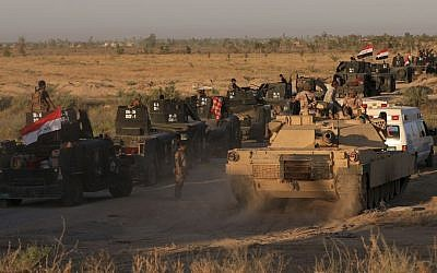 Iraqi military forces prepare for an offensive into Fallujah to retake the city from Islamic State militants in Iraq, Monday, May 30, 2016. (AP Photo/Khalid Mohammed)