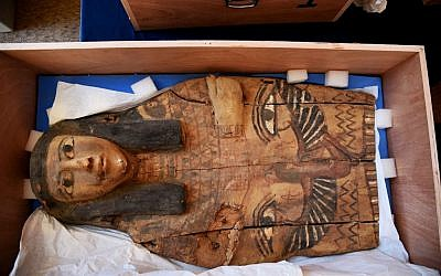 This undated photo released by the Israeli Foreign Ministry shows a part of sarcophagus cover in Israel. Israel's Antiquities Authority says the colorful sarcophagus covers date back as early as the 16th and 10th centuries BCE. (Israeli Foreign Ministry via AP)