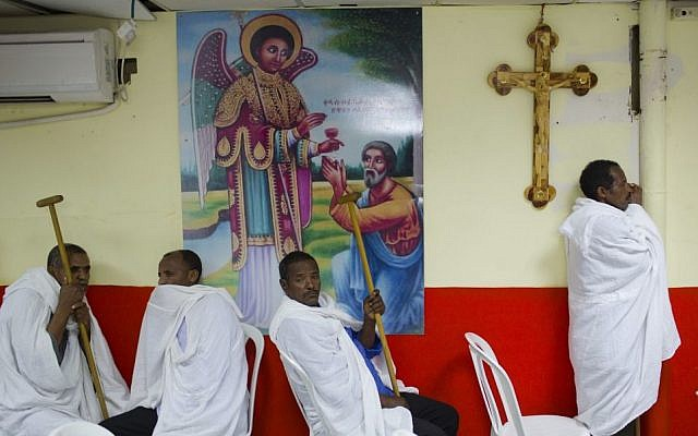 In this Saturday, May 7, 2016 photo, Eritrean Christian Orthodox migrants attend a mass at a makeshift church in Tel Aviv, Israel. (AP Photo/Oded Balilty)