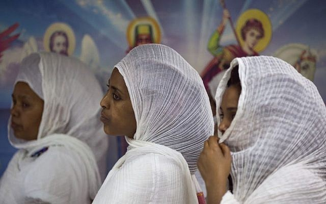 In this Saturday, May 7, 2016 photo, Eritrean Christian Orthodox migrant women stand during a mass at a makeshift church in Tel Aviv, Israel. (AP Photo/Oded Balilty)