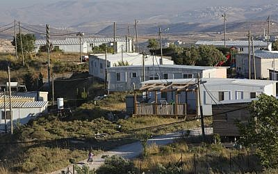 This May 18, 2016 photo shows buildings in Amona, an Israeli settlement outpost in the West Bank, east of Ramallah. (AP Photo/Oded Balilty)