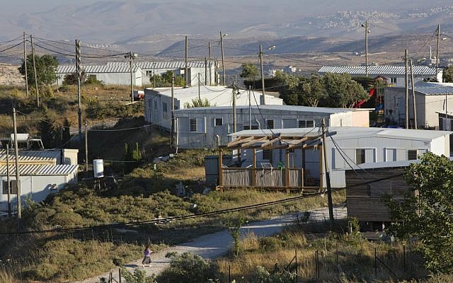 This May 18, 2016 photo shows buildings in Amona, an Israeli outpost in the West Bank, east of the Palestinian city of Ramallah. (AP Photo/Oded Balilty)