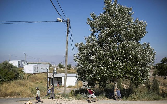 In this Wednesday, May 18, 2016 photo, Jewish settler children play next to a road in Amona, an Israeli outpost in the West Bank, east of the Palestinian city of Ramallah. (AP Photo/Oded Balilty)