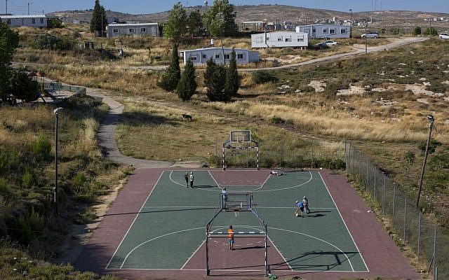 In this Wednesday, May 18, 2016 photo, Jewish youths play soccer in Amona, an Israeli outpost in the West Bank, east of the Palestinian town of Ramallah. (AP Photo/Oded Balilty)