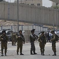 Israeli security forces at the main entrance of the Qalandiya checkpoint, a key crossing point between Jerusalem and the West Bank city of Ramallah, April 27, 2016. (AP Photo/Nasser Nasser)