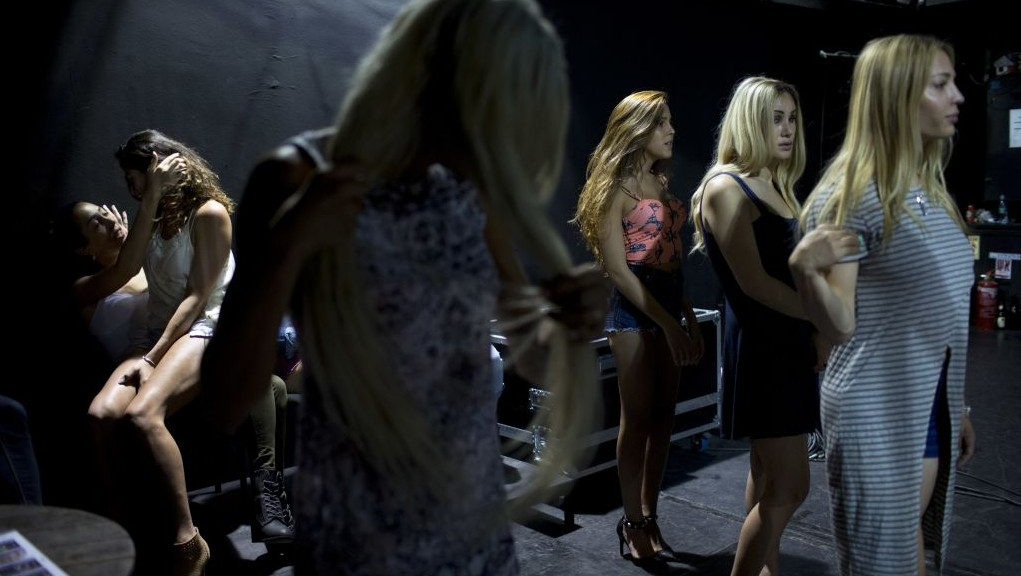 In this Tuesday, May 24, 2016 photo, contestants in the first Miss Trans Israel beauty pageant practice the walk on the stage during rehearsal in Tel Aviv, Israel. (AP Photo/Oded Balilty)