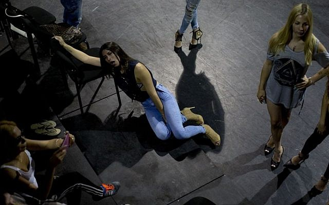 In this Sunday, May 22, 2016 photo, contestants in the first Miss Trans Israel beauty pageant, rest during rehearsal in Tel Aviv, Israel. (AP Photo/Oded Balilty)