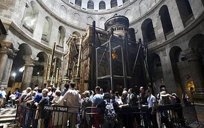 Christian pilgrims wait in line to visit the tomb of Jesus in the Church of Holy Sepulchre in Jerusalem Friday, May 20, 2016. (AP Photo/Mahmoud Illean)