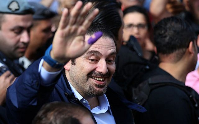 Lebanese prime minister Saad Hariri waves to his supporters after casting his ballot during municipal elections, outside a voting station in Beirut, Lebanon, May 8, 2016. (AP/Hussein Malla)