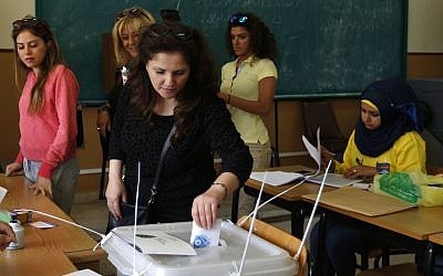 A Lebanese woman casts her vote at a polling station during the municipal elections in Beirut, Lebanon, May 8, 2016. (AP/Hassan Ammar)