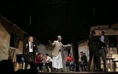 "In this Thursday, April 28, 2016 photo, Palestinian actors perform a Gaza version of Shakespeare's ""Romeo and Juliet"" play on the stage of a cultural center in Gaza City. (AP Photo/Khalil Hamra)"
