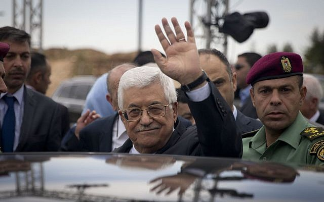 Palestinian Authority President Mahmoud Abbas waves to media during opening the Palestinian Museum to the public in the West Bank town of Bir Zeit , Wednesday, May 18, 2016. (AP Photo/Majdi Mohammed)