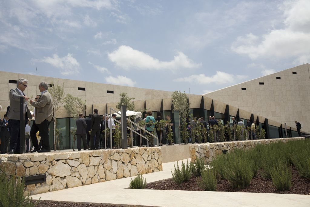 Palestinians visit the Palestinian Museum after it was officially opened to the public in West Bank town of Bir Zeit , Wednesday, May 18, 2016. (AP Photo/Majdi Mohammed)