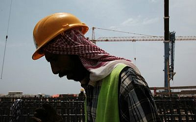 In this May 8, 2014, file photo, a man works at a construction site in Jiddah, Saudi Arabia. (AP Photo/Hasan Jamali, File)