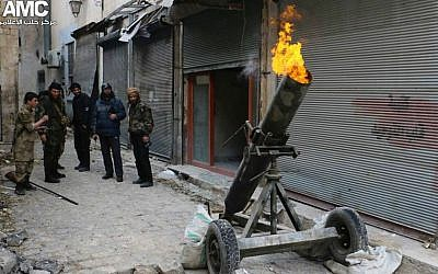 Syrian rebels fire locally made shells against Syrian government forces, in Aleppo, Syria, February 15, 2015 (AP Photo/Aleppo Media Center, Aleppo Media Center)