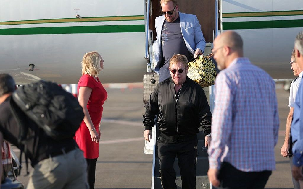 Elton John lands in Israel on May 25, 2016, a day before his concert at Yarkon Park in Tel Aviv (photo credit: Orit Pnini)