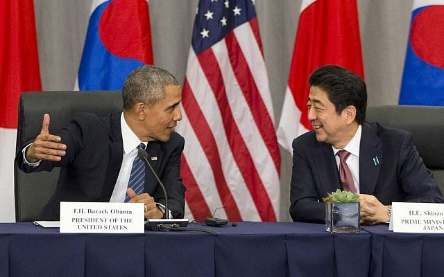 In this March 31, 2016, photo, U.S. President Barack Obama speaks with Japanese Prime Minister Shinzo Abe during their meeting at the Nuclear Security Summit in Washington. (AP Photo/Jacquelyn Martin, File)