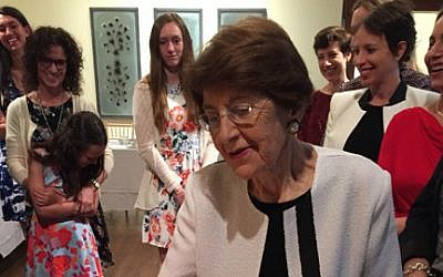 This April 22, 2016 photo provided by Jeanette Lerman-Neubauer shows Auschwitz survivor Rosalie Chris Lerman at Passover Seder. (Jeanette Lerman-Neubauer via AP)