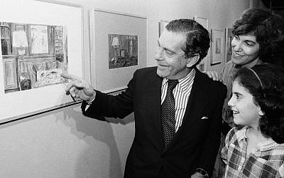 Morley Safer points to one of his watercolors displayed at a New York restaurant as his wife Jane and daughter Sarah look on. (AP Photo/ Richard Drew, File)