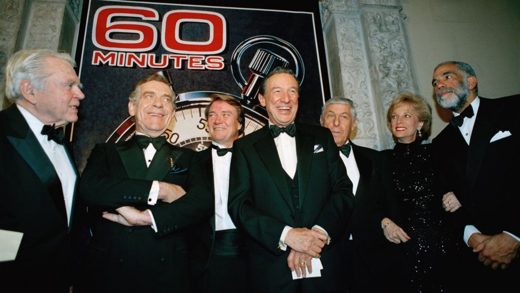 "The ""60 Minutes"" team, from left, Andy Rooney, Morley Safer, Steve Kroft, Mike Wallace, executive producer Don Hewitt, Lesley Stahl, and Ed Bradley pose at the Metropolitan Museum of Art in New York celebrating the show's 25th anniversary. (AP Photo/Mark Lennihan, File)"