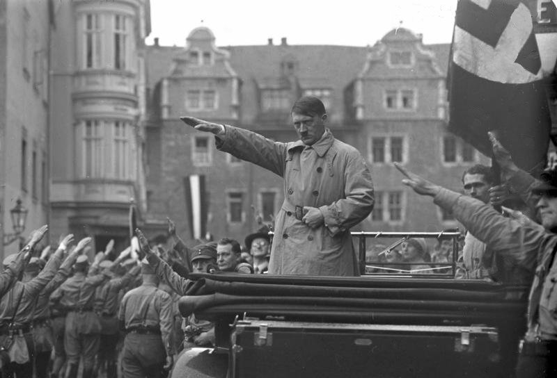Adolf Hitler at a Nazi rally in Weimar, Germany, October 1930 (public domain)