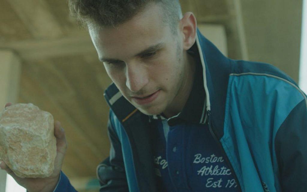 Noam Imber stars as David's son Omri in Eran Kolirin's latest film, 'Beyond the Mountains and Hills' (screenshot)
