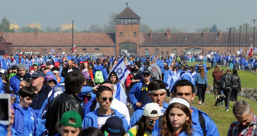 Participants of the yearly March of the Living walk in the former German Nazi Death Camp Auschwitz-Birkenau, in Brzezinka, Poland, May 5, 2016. (AP Photo/Alik Keplicz)