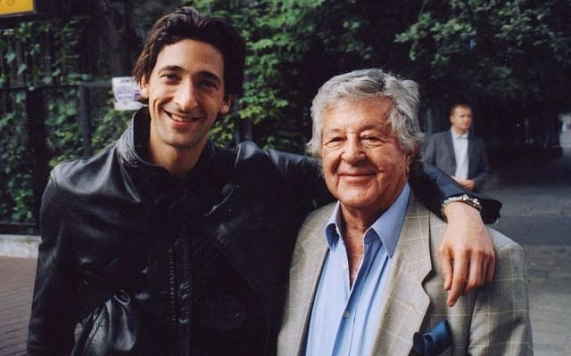 "In this 2000 photo, film producer Gene Gutowski, right, poses with actor Adrien Brody during the production of the Oscar-winning Holocaust film ""The Pianist."" (AP Photo/Adam Bardach)"