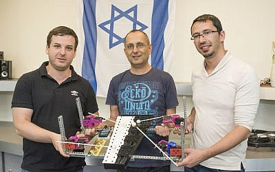 (L to R) Igor Kantor, Koby Kohai and Eli Zalianski hold their robot xylophone player (Shitzu Photographers, Technion Spokesperson's Office)