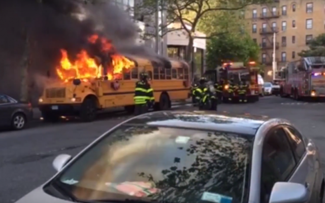 A bus in flames on May 8, 2016 in front of the Beth Rivkah School for Girls in Crown Heights, Brooklyn (screen capture: YouTube)